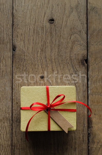 Yellow Gift Box with Red Ribbon and Vintage Style Blank Tag Stock photo © frannyanne
