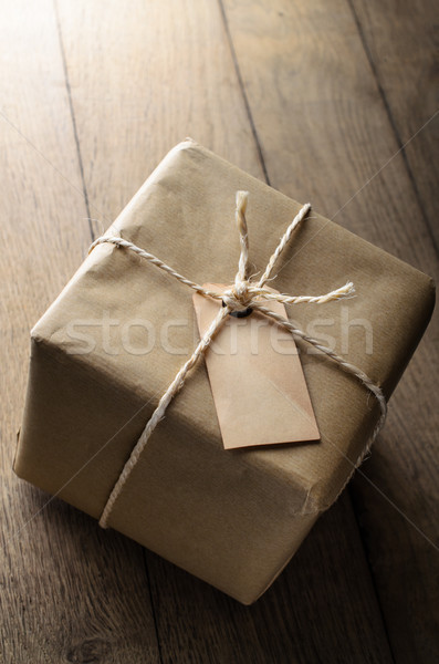Brown Paper Parcel with String and Blank Weathered Label Stock photo © frannyanne