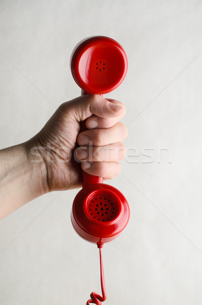 Hand Holding Out Red Retro Telephone Handset Stock photo © frannyanne