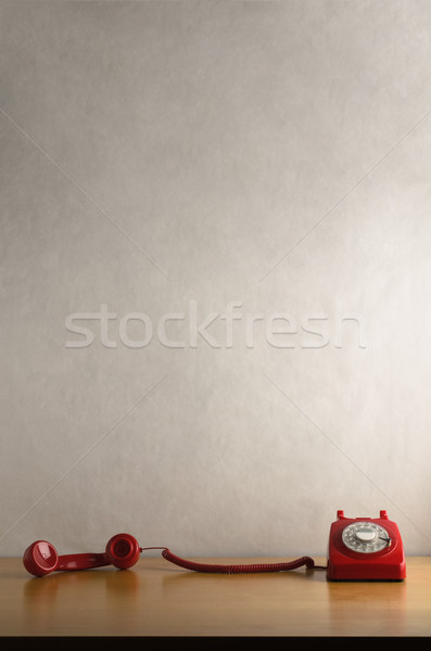 Retro Red Telephone with Receiver Off Hook and Trailing across D Stock photo © frannyanne