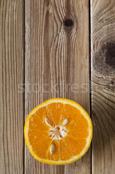 Cut Orange Overhead on Wood Stock photo © frannyanne