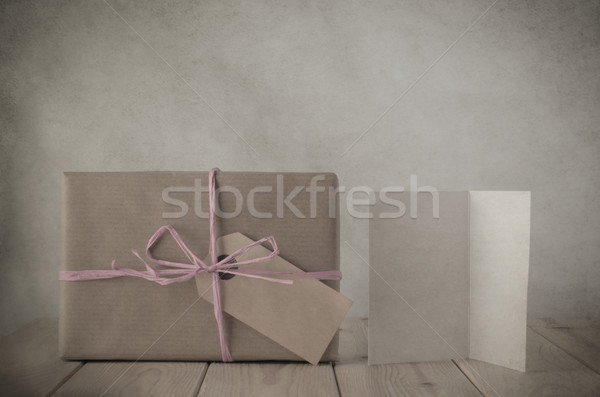 Brown Paper Gift Box with Pink Raffia and Greeting Card Stock photo © frannyanne