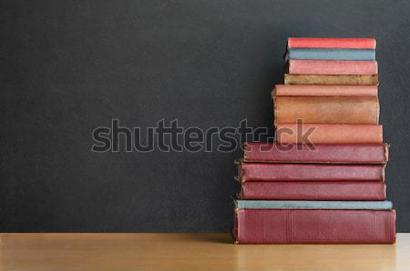 Book Stack on Desk with Chalkboard Background - Croos Processed Stock photo © frannyanne