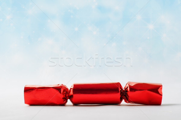 Red Christmas Cracker with Star Spangled Snowfall Background Stock photo © frannyanne