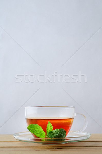 Lemon Tea in Glass Cup with Mint Sprig Stock photo © frannyanne