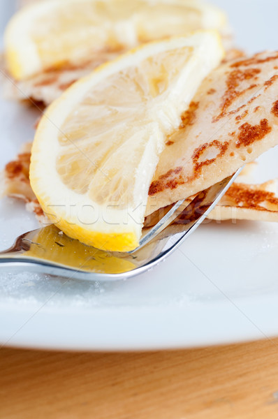 Pancake and Lemon Slice on Plate with Fork Stock photo © frannyanne