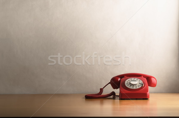 Retro Red Telephone on Light Wood Veneer Desk  Stock photo © frannyanne