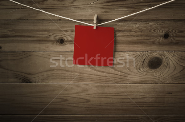 Blank Red Note Paper Pegged to String against Wood Planks Stock photo © frannyanne