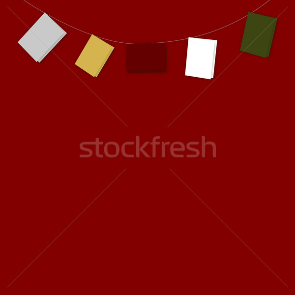 String of Plain Coloured Cards on Red Stock photo © frannyanne