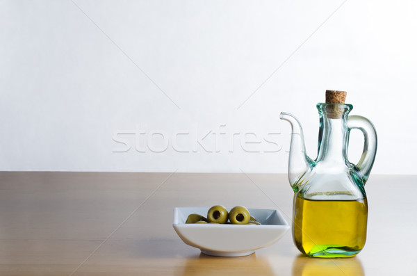 Olive Oil Jug with Olives Stock photo © frannyanne