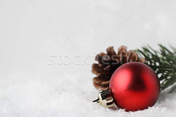 Christmas Border Background with Red Bauble and Foliage on Snow Stock photo © frannyanne