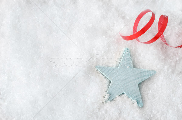 Stock photo: Blue Star on Snow with Red Ribbon Swirl
