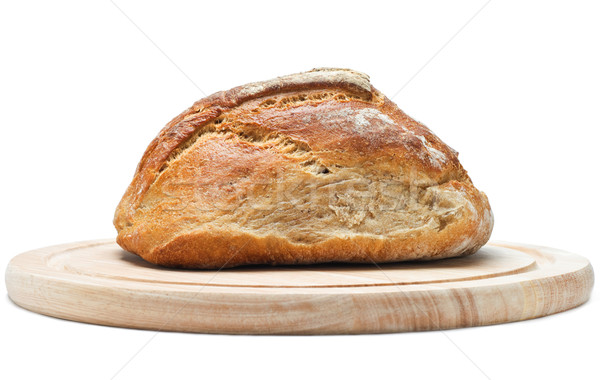 Loaf of Bread on Chopping Board Stock photo © frannyanne