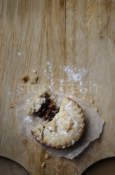 Stock photo: Overhead of  Crumbling Christmas Mince Pie on Old Wooden Board
