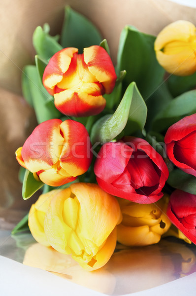 Bouquet of Red and Yellow Spring Tulips Wrapped in Brown Paper Stock photo © frannyanne