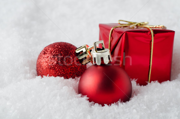 Red Christmas Decorations in Snow Stock photo © frannyanne
