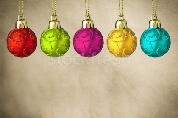 Row of Christmas Baubles on Parchment Stock photo © frannyanne