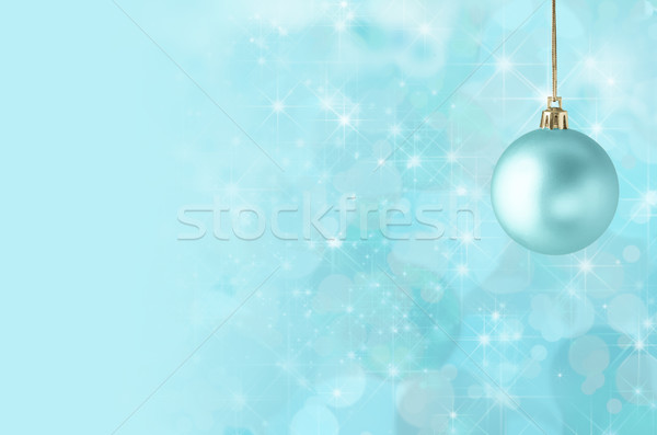 Christmas Bauble on Starry Bokeh Background Stock photo © frannyanne
