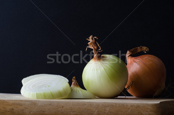 Onions in Preparation on Chopping Board Stock photo © frannyanne