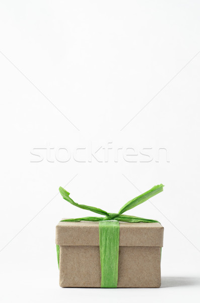 Simple Brown Gift Box Tied Up with Green Raffia Ribbon Stock photo © frannyanne