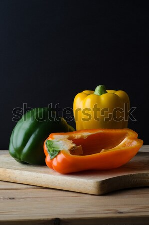 Bell Peppers Arrangement on Wooden Board  Stock photo © frannyanne