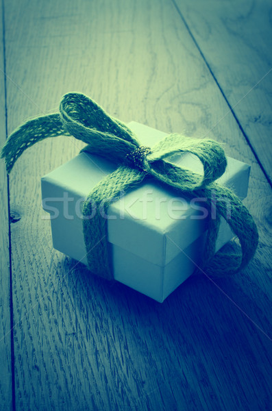 White Gift Box with Green Ribbon on Wood Table - Cross Processed Stock photo © frannyanne