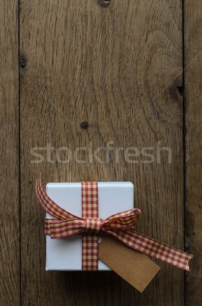Gift Box with Gingham Ribbon and Blank Label on Wood Stock photo © frannyanne