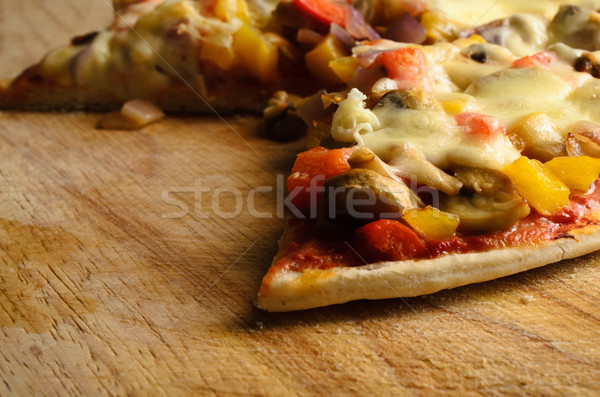 Partly Eaten Vegetarian Pizza on Chopping Board Stock photo © frannyanne