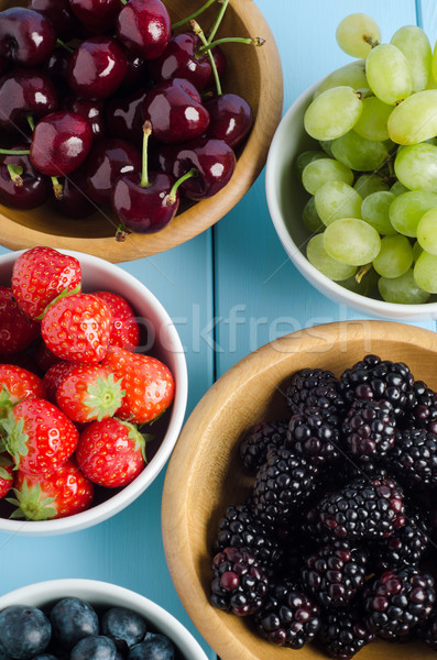 Five Fruit Types in Bowls from Above on Wood Plank Table Stock photo © frannyanne