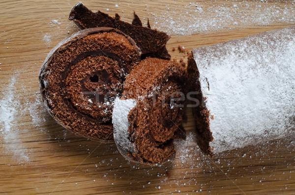 Stock photo: Chocolate Christmas Yule Log with Snowy Sprinkles on Wood