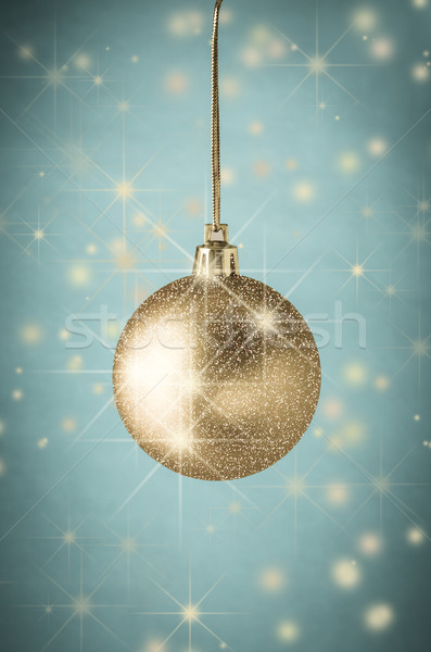 Gold Glitter Christmas Bauble on Turqoise with Stars Stock photo © frannyanne