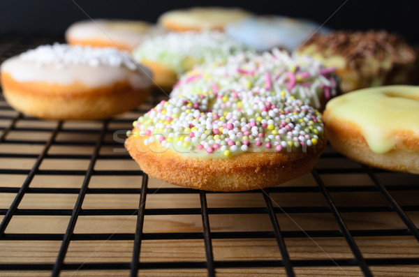 Home Baked Mini Doughnut Cakes with Sprinkles on Cooling Rack Stock photo © frannyanne
