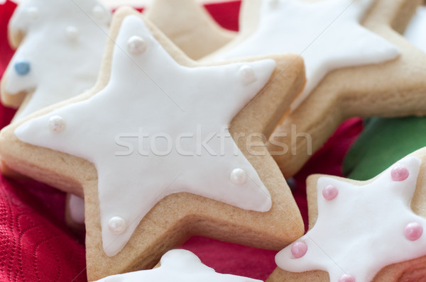 Star Shaped Christmas Biscuits with White Icing Stock photo © frannyanne