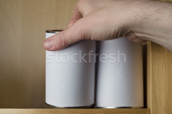 Male Hand Choosing Between Two Unbranded Tinned Products Stock photo © frannyanne