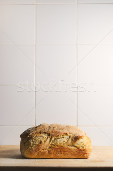 Stock photo: Whole Loaf of Crusty Bread with White Tiled Background