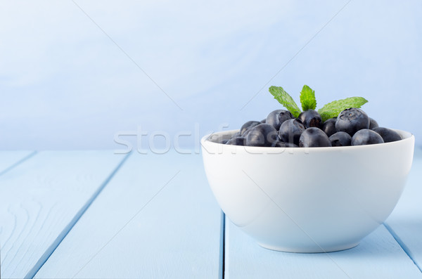 Bowl of Blueberries on Blue Stock photo © frannyanne