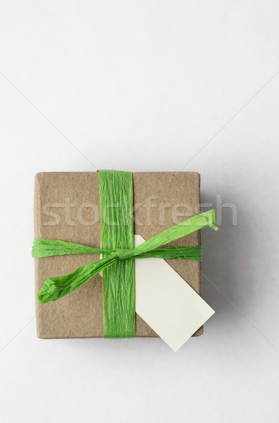 Simple Gift Box with Green Raffia Ribbon from Above Stock photo © frannyanne