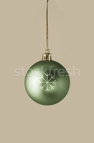 Green Christmas Bauble with Glittery Snowflake Stock photo © frannyanne