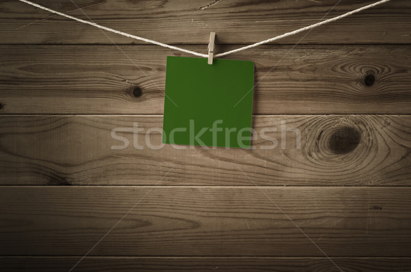 Blank Green Message Pegged to String against Wood Planks Stock photo © frannyanne