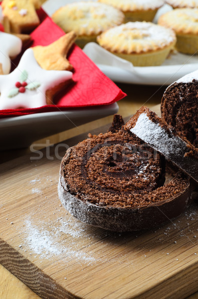 Chocolate Christmas Yule Log, Biscuits and Mince Pies on Table Stock photo © frannyanne