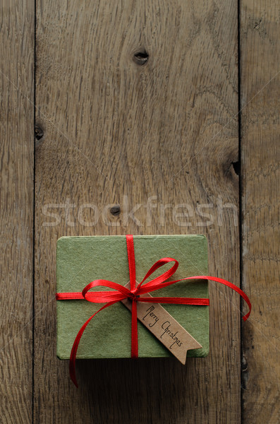 Plain Green Gift Box with Red Ribbon and Vintage Style Christmas Stock photo © frannyanne