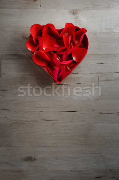 Overhead of Rose Petals in Heart Shaped Bowl on Wood  Stock photo © frannyanne