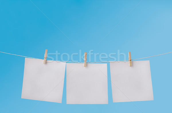 Three Blank Notes Pegged on Washing Line against Blue Sky Stock photo © frannyanne