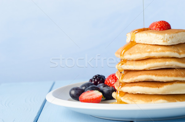 Stacked Pancakes and Fruit with Maple Syrup Stock photo © frannyanne