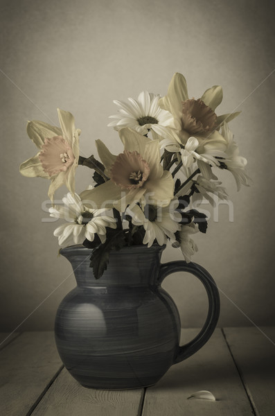 Fading Flowers in Jug Stock photo © frannyanne