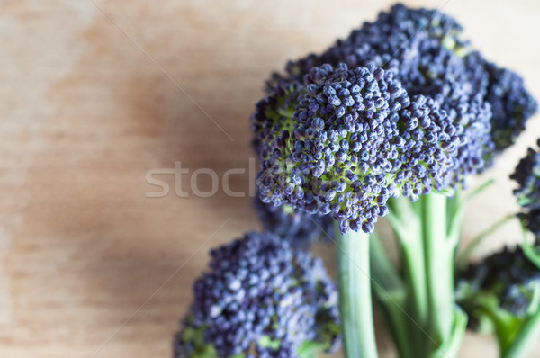 Purple Sprouting Broccoli with Green Stem on Wood Stock photo © frannyanne