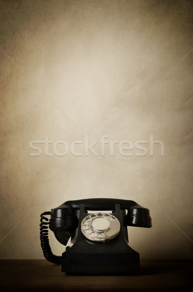 Viintage Black 1940s Telephone on Wood with Aged Effects Stock photo © frannyanne