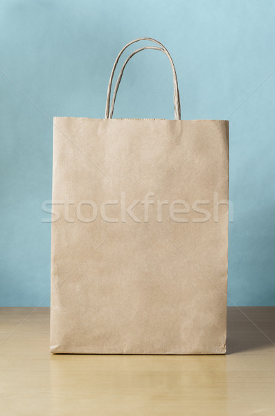 Blank Brown Shopping Bag on Table with Blue Background Stock photo © frannyanne