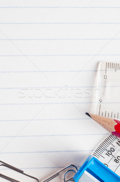 Stationery On Lined Paper Background Stock Photo