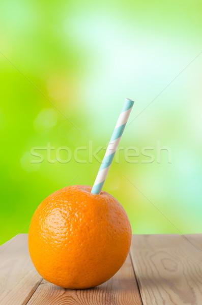 Fresh Orange Drink in Garden Stock photo © frannyanne